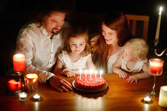 A family celebrating daughter's fifth birthday Stock Photography