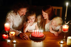 A family celebrating daughter's fifth birthday Stock Photos