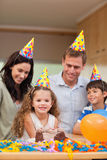 Family celebrating daughters birthday Royalty Free Stock Images