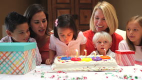 Family Celebrating Daughters Birthday Stock Photo