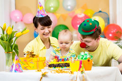 Family celebrating first birthday of baby girl. Family celebrating first birthday of kid girl Royalty Free Stock Images