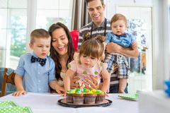 Family Celebrating Girl's Birthday Stock Images