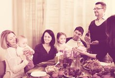 Family celebrating girl`s birthday. Positive relatives wishing little girl happy birthday and giving presents. Focus on girl royalty free stock images