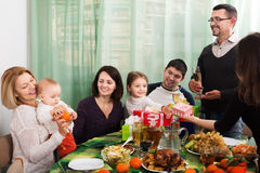Family celebrating girl`s birthday. Positive relatives wishing little girl happy birthday and giving presents. Focus on girl stock photos