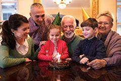 Family celebrating girls birrhday at home royalty free stock photo