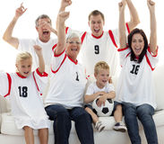 Family celebrating a goal at home Royalty Free Stock Image