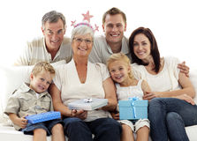 Family celebrating grandmother's birthday Royalty Free Stock Photos