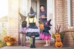 Family celebrating Halloween Royalty Free Stock Image