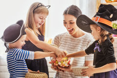 Family celebrating Halloween Stock Images