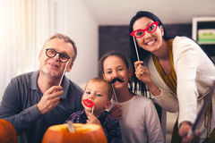 Family are celebrating Halloween. Stock Photos