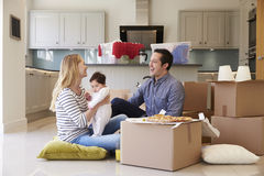 Family Celebrating Moving Into New Home With Pizza Royalty Free Stock Images