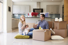 Family Celebrating Moving Into New Home With Pizza Stock Photos