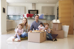 Family Celebrating Moving Into New Home With Pizza stock photo