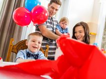 Family Celebrating Son's Birthday Royalty Free Stock Photography