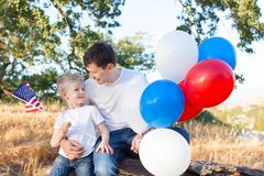 Family celebrating 4th of July royalty free stock photo