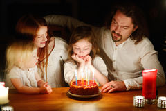 Family celebrating their daughter's birthday stock photography