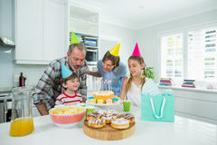 Family celebrating their sons birthday in kitchen royalty free stock image