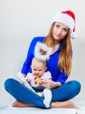Christmas woman with cute baby. Royalty Free Stock Photo