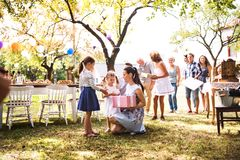 Family celebration or a garden party outside in the backyard. Family celebration outside in the backyard.Big garden party. Birthday party Royalty Free Stock Photography