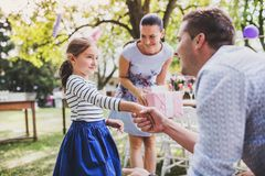 Family celebration or a garden party outside in the backyard. Family celebration outside in the backyard. Big garden party. Birthday celebration Royalty Free Stock Photography