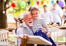 Family celebration or a garden party outside in the backyard. Royalty Free Stock Photography