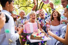 Family celebration or a garden party outside in the backyard. Family celebration outside in the backyard. Big garden party. Birthday party Stock Photo