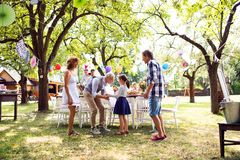 Family celebration or a garden party outside in the backyard. Family celebration outside in the backyard.Big garden party. Birthday celebration Royalty Free Stock Images