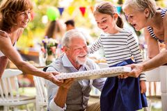Family celebration or a garden party outside in the backyard. Family celebration outside in the backyard. Big garden party. Birthday celebration Stock Image