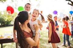 Family celebration or a garden party outside in the backyard. Family celebration outside in the backyard. Big garden party or birthday party. Young mother stock images