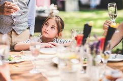 Family celebration or a garden party outside in the backyard. Family celebration outside in the backyard. Big garden party Royalty Free Stock Image