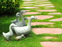 Family of cement ducks in the garden Royalty Free Stock Photography