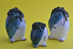 Family of ceramic puppets singing Royalty Free Stock Image