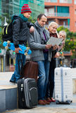 Family checking direction in map Royalty Free Stock Image