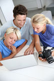Family checking on image shots Royalty Free Stock Photography