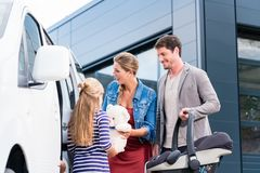 Family checking new car in car dealership Stock Photography