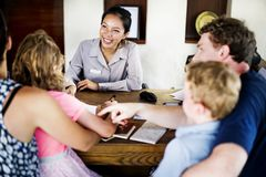 Family checking in at resort reservation counter royalty free stock photo