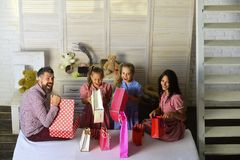 Family with cheerful faces open presents at home stock image