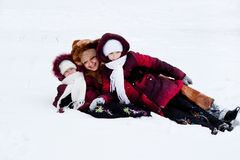 Family cheerfully play to snow Stock Photos