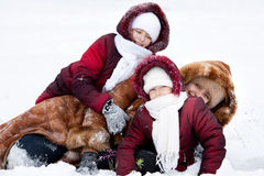 Family cheerfully play to snow Stock Photography