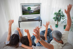 Family cheering and watching the world cup at home Stock Photography