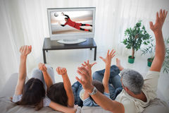 Family cheering and watching the world cup at home Stock Images