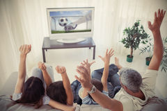 Family cheering and watching the world cup at home Stock Photo
