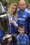 Family of Chelsea supporters holding the trophy Royalty Free Stock Images