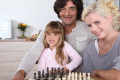 Family by chess board Royalty Free Stock Photo