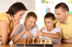 Family at the chess Royalty Free Stock Photos