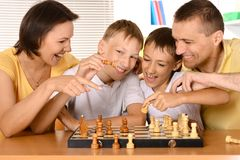 Family at the chess Stock Photos