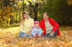 Family with child in autumn park Royalty Free Stock Photography