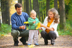 Family with child in autumnal wood Royalty Free Stock Photos