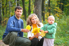 Family with child in autumnal wood. Stock Photo