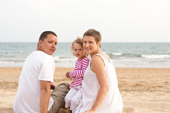 Family with child on the beach Stock Image